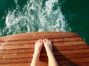 teak swim platform, teal water, wakeboat on lake michigan, Nautique on lake michigan