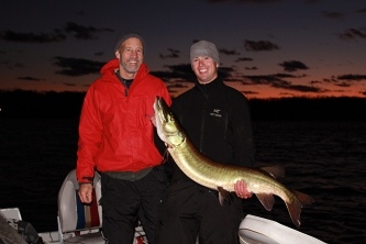 Dad's trophy musky, musky fishing at sunset, wisconsin musky fishing
